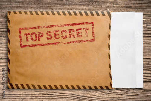 Photo  Envelope with top secret stamp and blank papers.