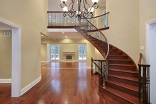 Foyer With Balcony And Curved ...
