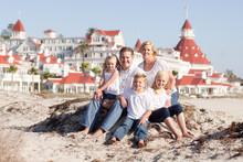 Happy Caucasian Family In Front Of Hotel Del Coronado