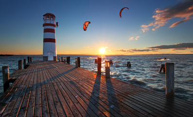 Fototapeta Lighthouse in Lake Neusiedl at sunset - Lower Austria