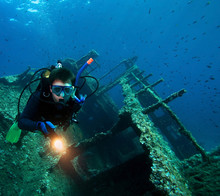 Scuba Diver With Underwater Li...