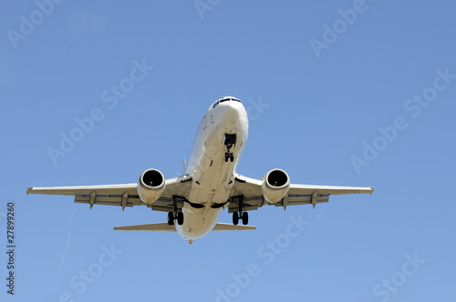 Fotografia  Aircraft on a blue sky