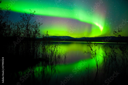 Northern lights mirrored on lake Poster