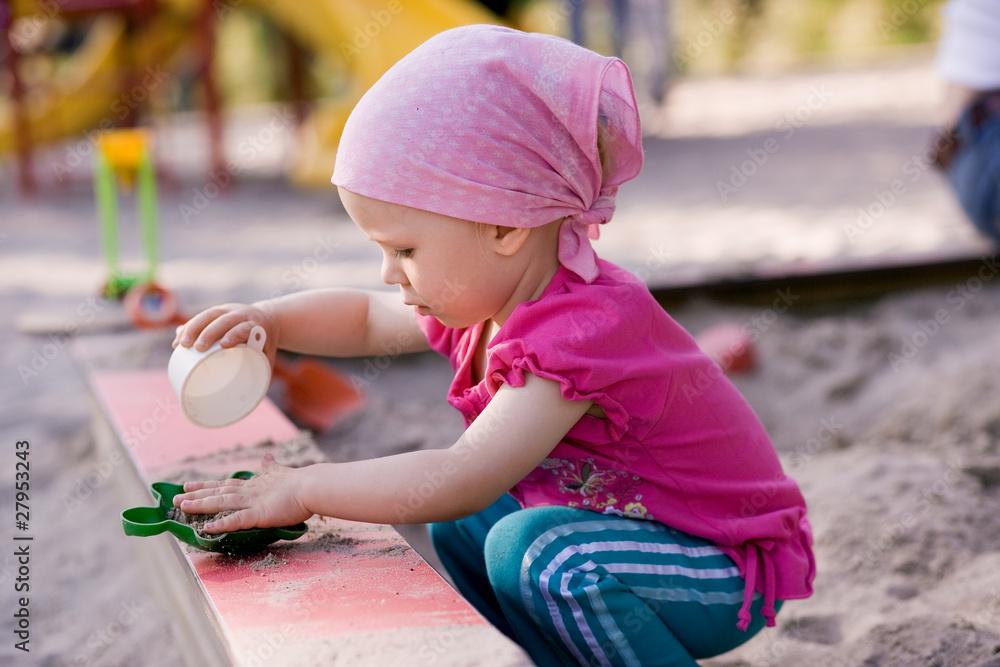 Fototapeta little girl in sandbox