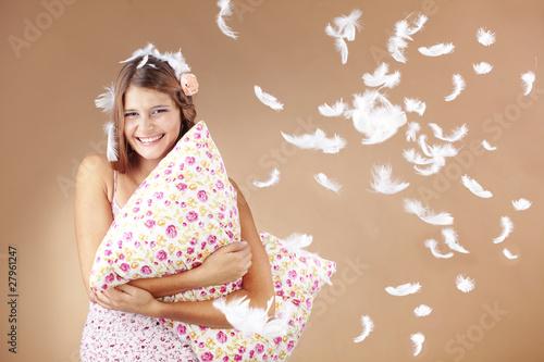 Photo Girl holding pillow