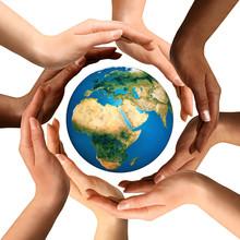Multiracial Hands Surrounding ...