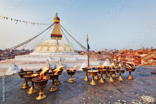 Staande foto Nepal Many sacred candles in front of Boudha Nath (Bodhnath) stupa in