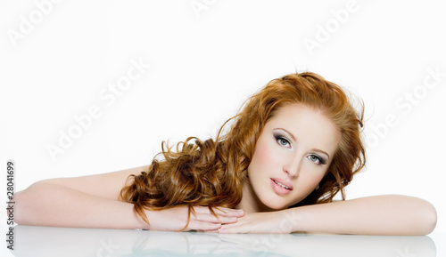 Fotografija  Beautiful red-haired woman with long  wavy hairs