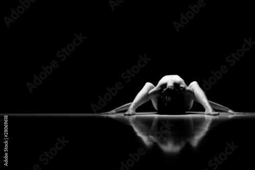 black and white artistic nude on black background