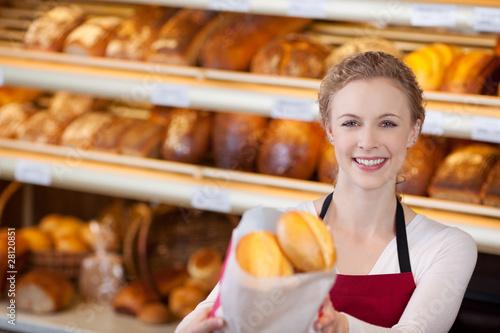 In de dag Bakkerij freundliche verkäuferin in der bäckerei