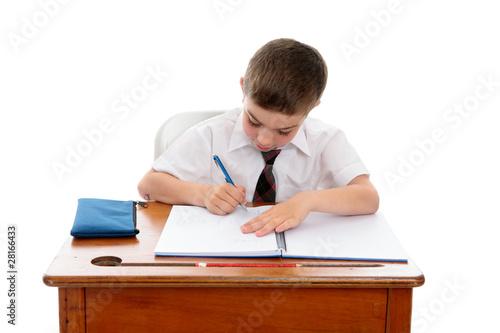 Obraz na plátně Little boy doing school work or homework