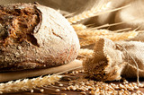 Fototapeta Kitchen - Close-up on traditional bread. Shallow DOF