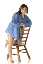 Teen On A Ladderback Chair