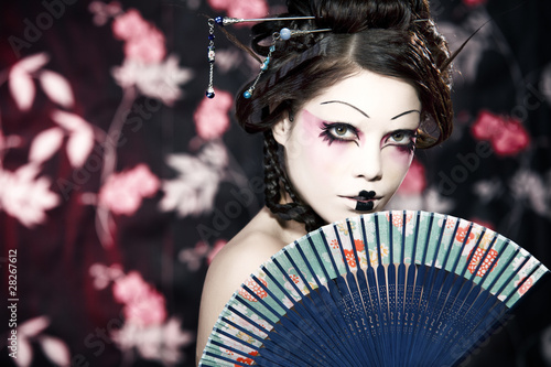 Fotomural portrait of a beautiful white girl in geisha style