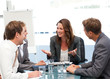 Attractive businesswoman laughing with her team