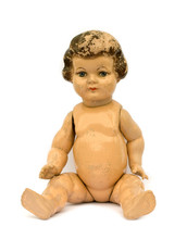 Old Worn Antique Doll On White Background.