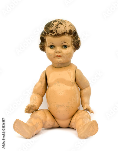 Tablou Canvas Old worn antique doll on white background.