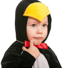 Portrait Of A Thoughtful Toddler In A Penguin Carnival Suit