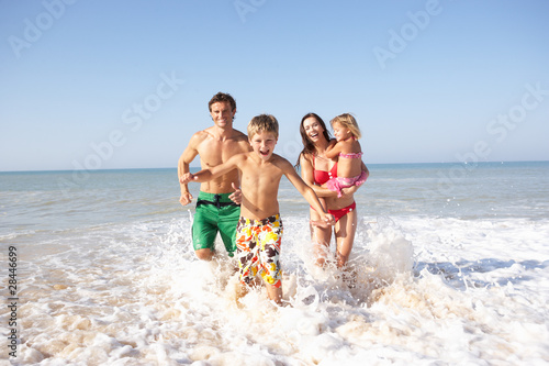 Young family play on beach - 28446699