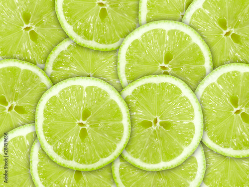 Aluminium Prints Slices of fruit Abstract green background with citrus-fruit of lime slices