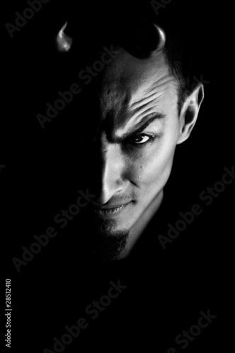 Low key portrait of evil. Dark portrait of devil looking man wit Poster Mural XXL