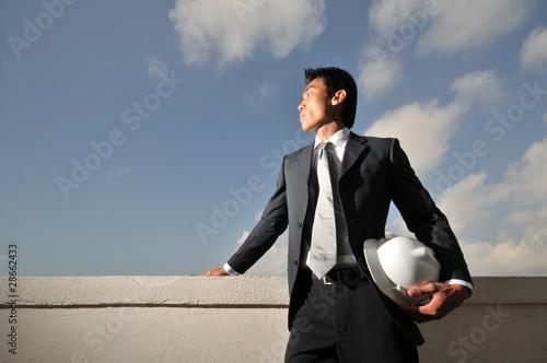 Photo  Asian Man holding a hard hat