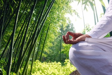 Fototapeta Do Spa Man relaxing by bamboo forest