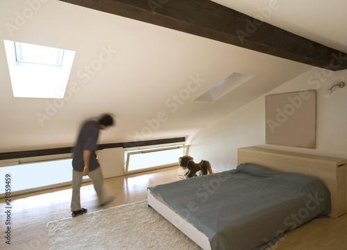 camera da letto mansardata - Buy this stock photo and explore ...