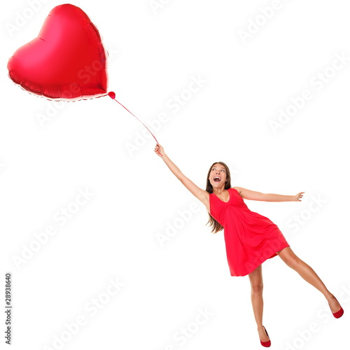 Photo  Valentines day woman flying with heart balloon