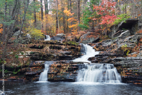 Tuinposter Watervallen Autumn Waterfall in mountain