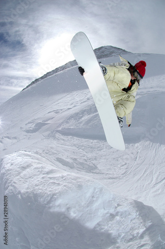 Fotografie, Obraz  Jumping snowboarder in the mountains