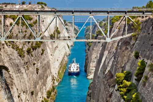 Fotografie, Tablou The boat crossing the Corinth channel in Greece