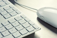 Close-up Of White Keyboard And...