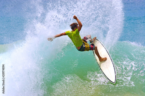 Fotografie, Obraz  surfer hitting wave lip creates a water curtain spray