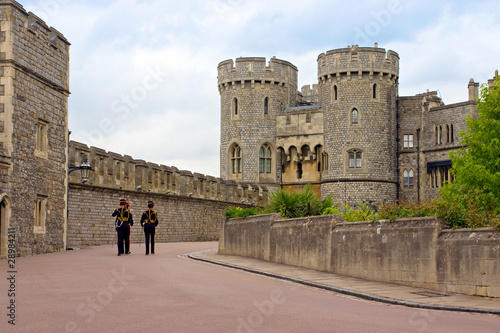 Photo  Queen's Guard soldiers marching in Windsor Castle, The United Ki
