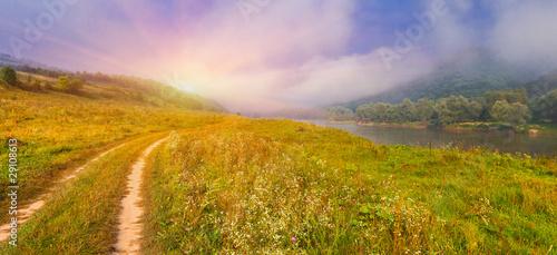 Foto op Plexiglas Blauwe hemel Summer landscape near the river. Sunrise
