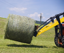 Tractor Working With Hay Bale