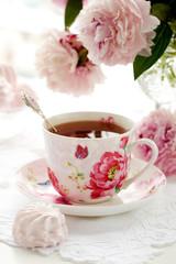FototapetaA cup of black tea and peony