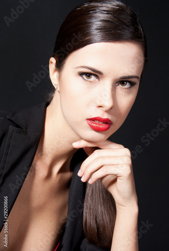 Fotobehang womenART Beautiful woman with red lipstick isolated on black