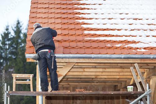 фотография  Dachdeckerarbeit bei Schnee