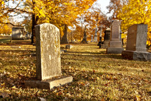 Tombstone At Cemetery In Fall