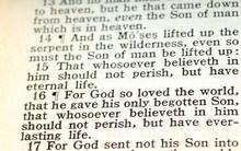 An Old King James Version Bible Open To John 3:16