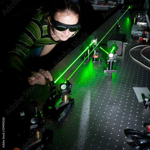 Fotografie, Obraz  female scientist doing research in a quantum optics lab