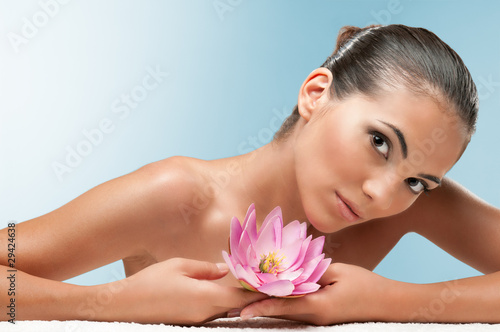 Beauty with lotus flower at spa