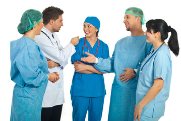 Cheerful team of doctors having conversation