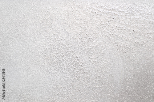 Valokuvatapetti White wall with a powdery substance