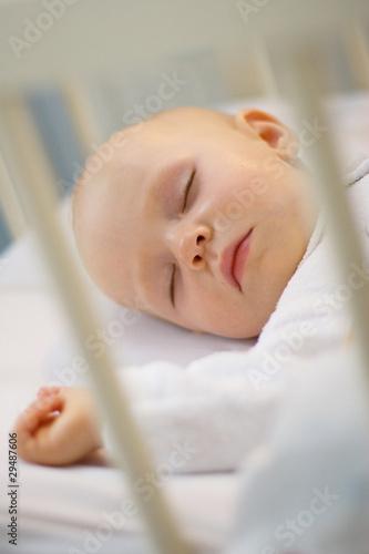 Fototapeta baby sleeping in crib obraz