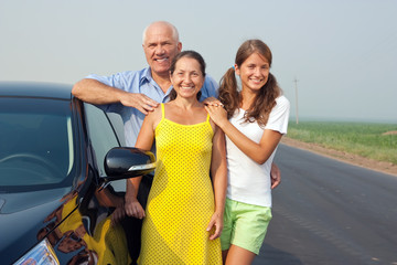 Family near black car