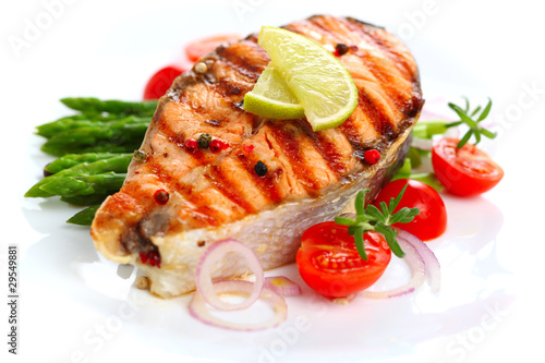 Keuken foto achterwand Vis Grilled salmon with lime, asparagus and cherry tomatoes on white