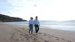 Senior couple walking by the beach